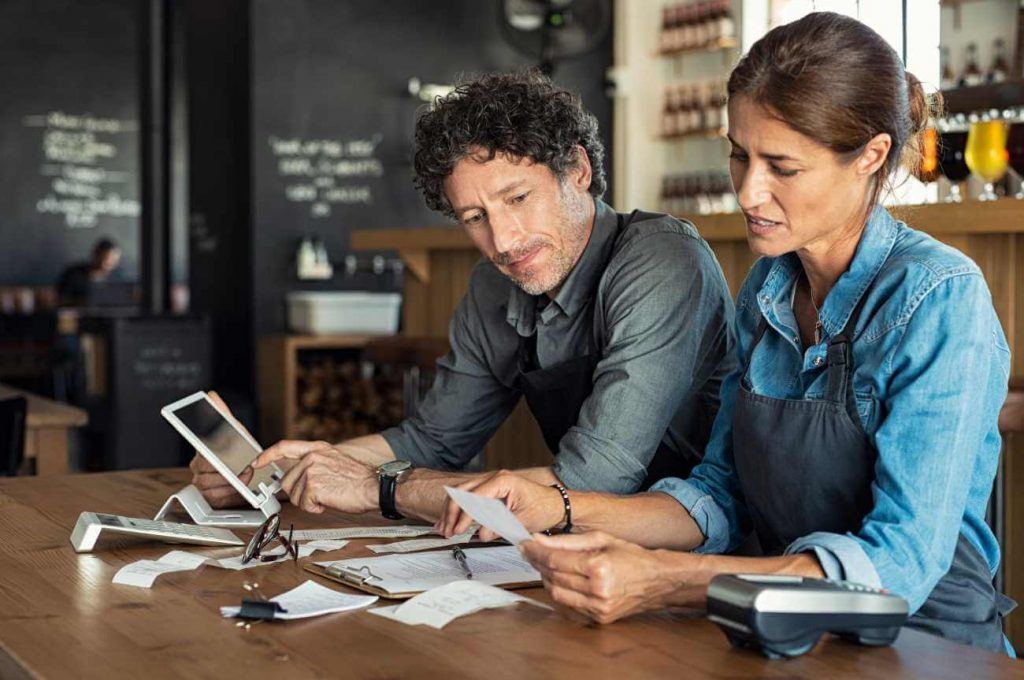 male-and-female-business-owner-doing-paper-work