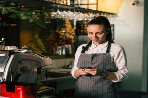 Restaurant-worker-on-cell-phone