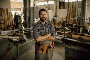 factory-worker-with-arms-crossed-in-machine-shop