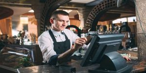 Restaurant-worker-at-point-of-sale-system